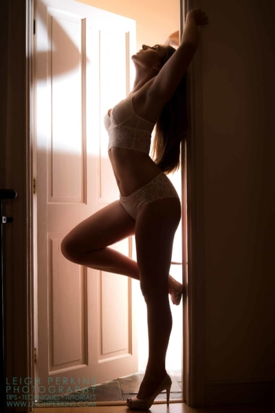 Model silhouetted in a doorway