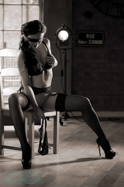 Model posed in a chair with blindfold